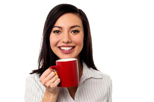 Woman enjoying coffee during work break