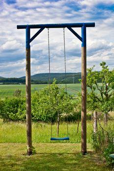 Lonely swing in a garden