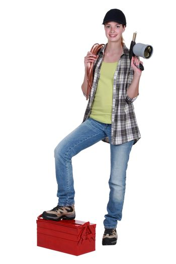 Female plumber with jug in hand