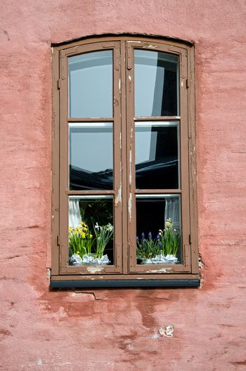 old ornamented window with flowers