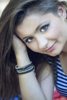 a close up portrait of a brunette beautiful girl