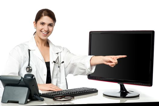 Female physician pointing at computer screen