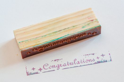 Congratulation stamped on paper