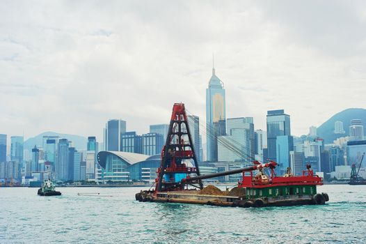 Barge in front of business district in Hong Kong. Some 456,000 vessels arrived in and departed from Hong Kong during the year, carrying 243 million tonnes of cargo