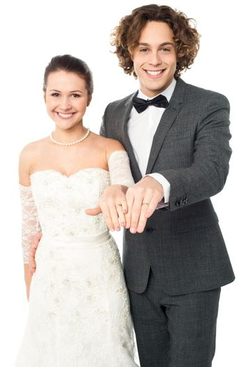 Lovely couple showing their wedding bands