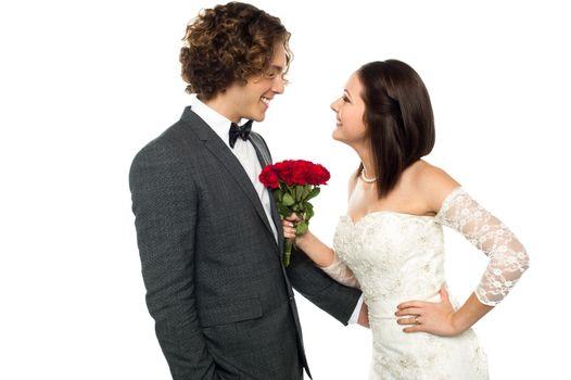 Girl flirting with her man, wedding concept