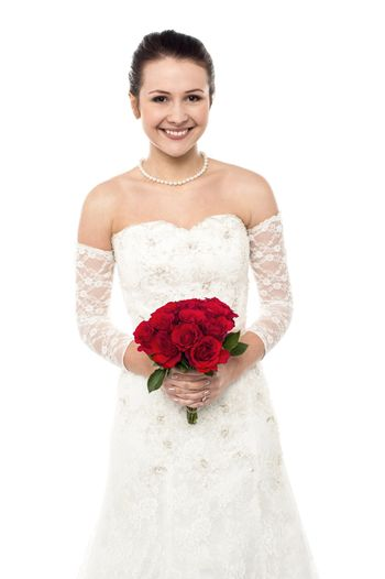 Cheerful young girl in bright bridal dress