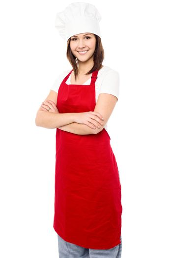 Young baker woman with folded arms