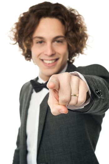 Handsome man in bowtie pointing you out