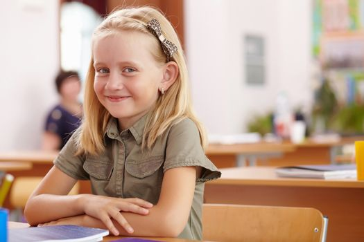 Little girl at school class