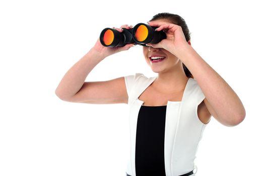 Lady looking through the binocular