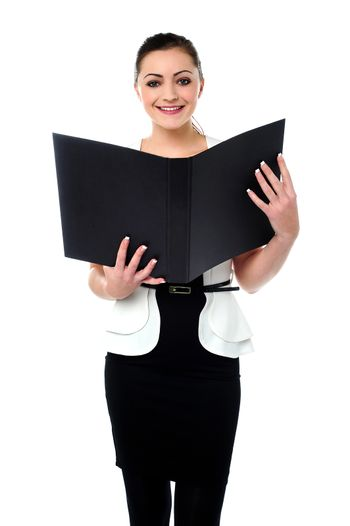 Fashionable businesswoman reviewing a file