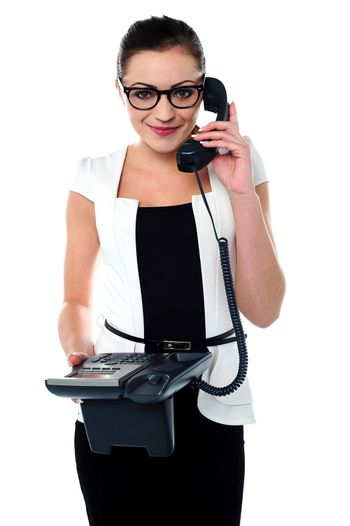 Bespectacles secretary answering a call