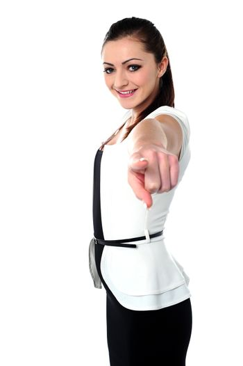 Charming girl pointing towards you