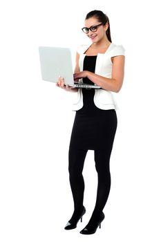 Female secretary using laptop