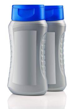 gray bottles of shampoo