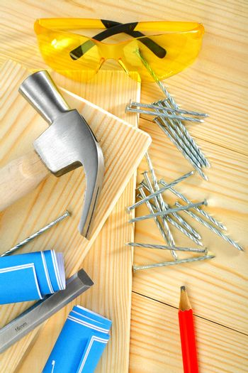 composition of carpentry tools on  wooden background