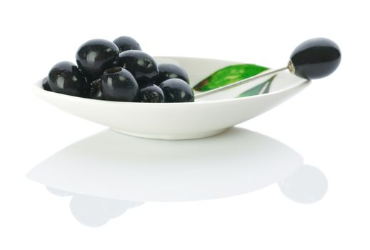 olive on a plate with skewer