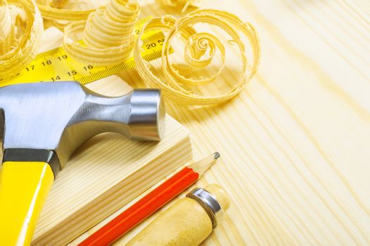 composition of carpentry tools on pine boards