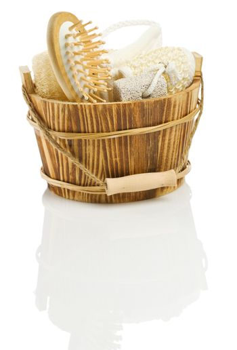 Sauna accessory in a wooden bucket