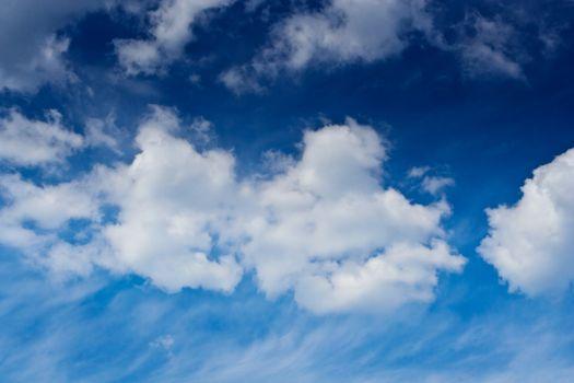 cumulus and cirrus clouds on a blue sky