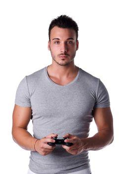 Handsome young man using joystick or joypad for videogames