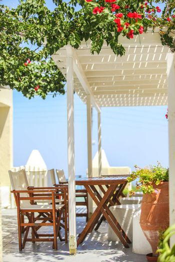 Typical Greek outdoor cafes on the island of Santorini