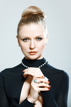 Stylish lady in studio with luxurious jewelry
