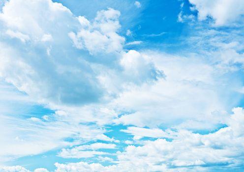 blue heaven vith sparse cumulus clouds