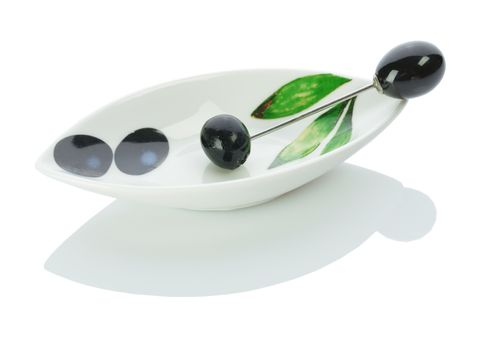 single olive on a plate with skewer