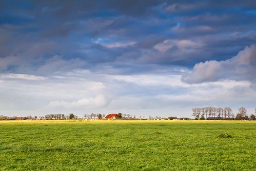 charming house on farmland at storm