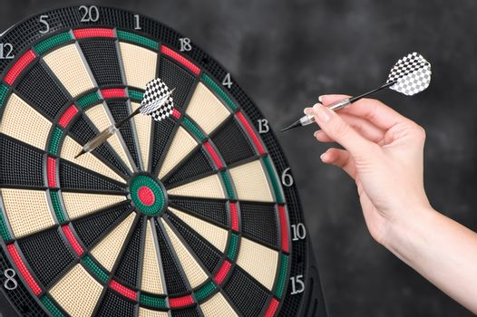 arrow in hand and dartboard