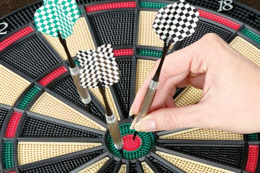 Taking out dart from dartboard