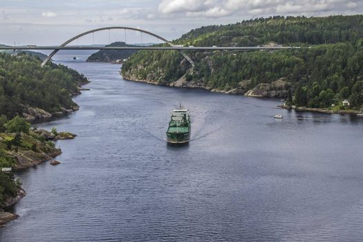 Cargo ship Kalkvik  going to the port of Halden, Norway in order to unload clay. The picture is shot from Svinesund Bridge.