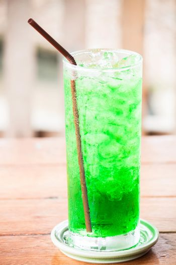 Relaxing with iced green drink on table