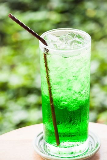 Fresh sweet green drink with ice cubes