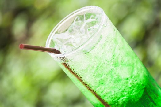 Refreshing glass of non alcohol cold green drink