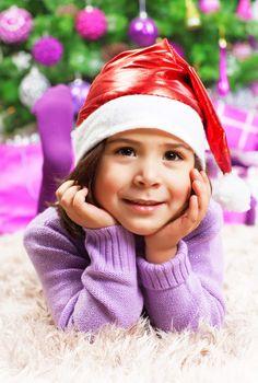 Happy little girl in Christmas eve