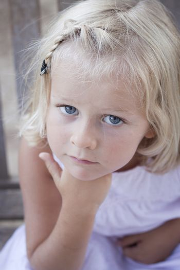 Little girl looking at camera