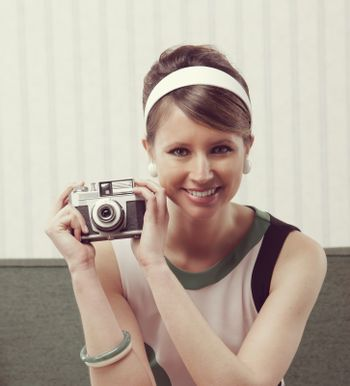 Retro woman with old-fashioned camera