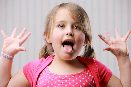 Beautiful little girl making funny face