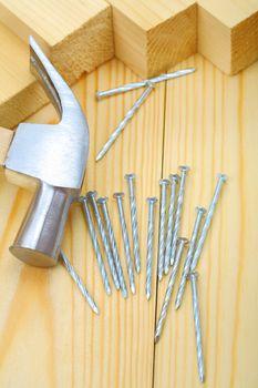 hammer nails and timber