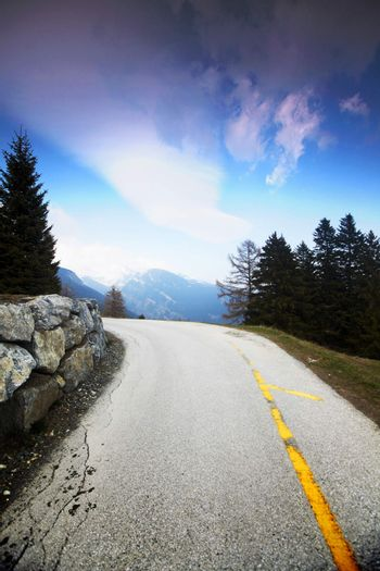 mountain road under blue sky