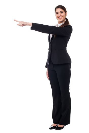 Businesswoman pointing away