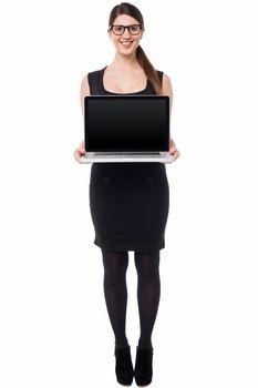 Saleswoman presenting brand new laptop