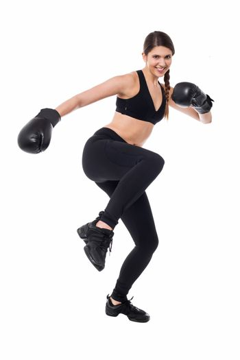 Pretty young boxer woman in action