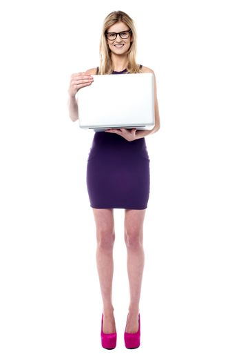 Attractive sales girl holding laptop