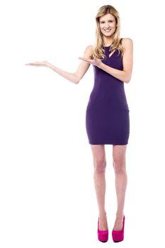 Sales girl presenting something