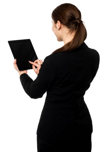 Business executive operating touch pad