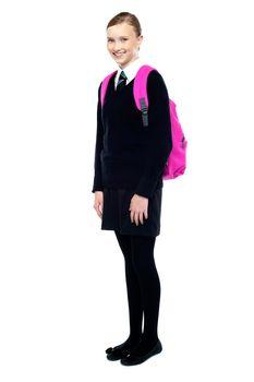 Schoolgirl in uniform, full length shot